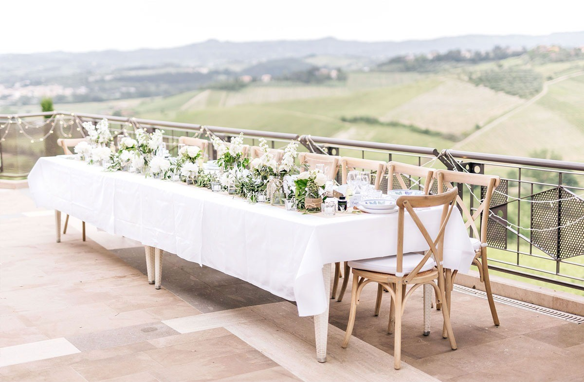 Rustic wedding table in the countryside of Tuscany