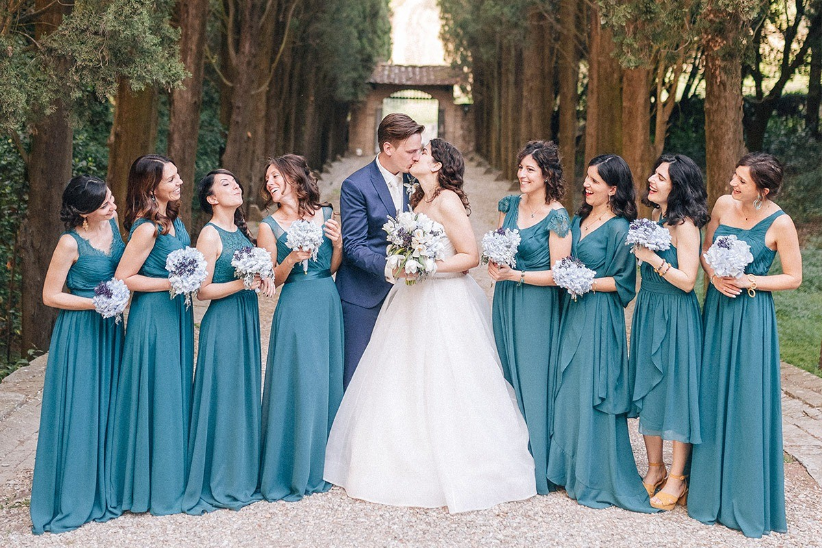 Teal blue wedding party in Castello Il Palagio in the Chianti region