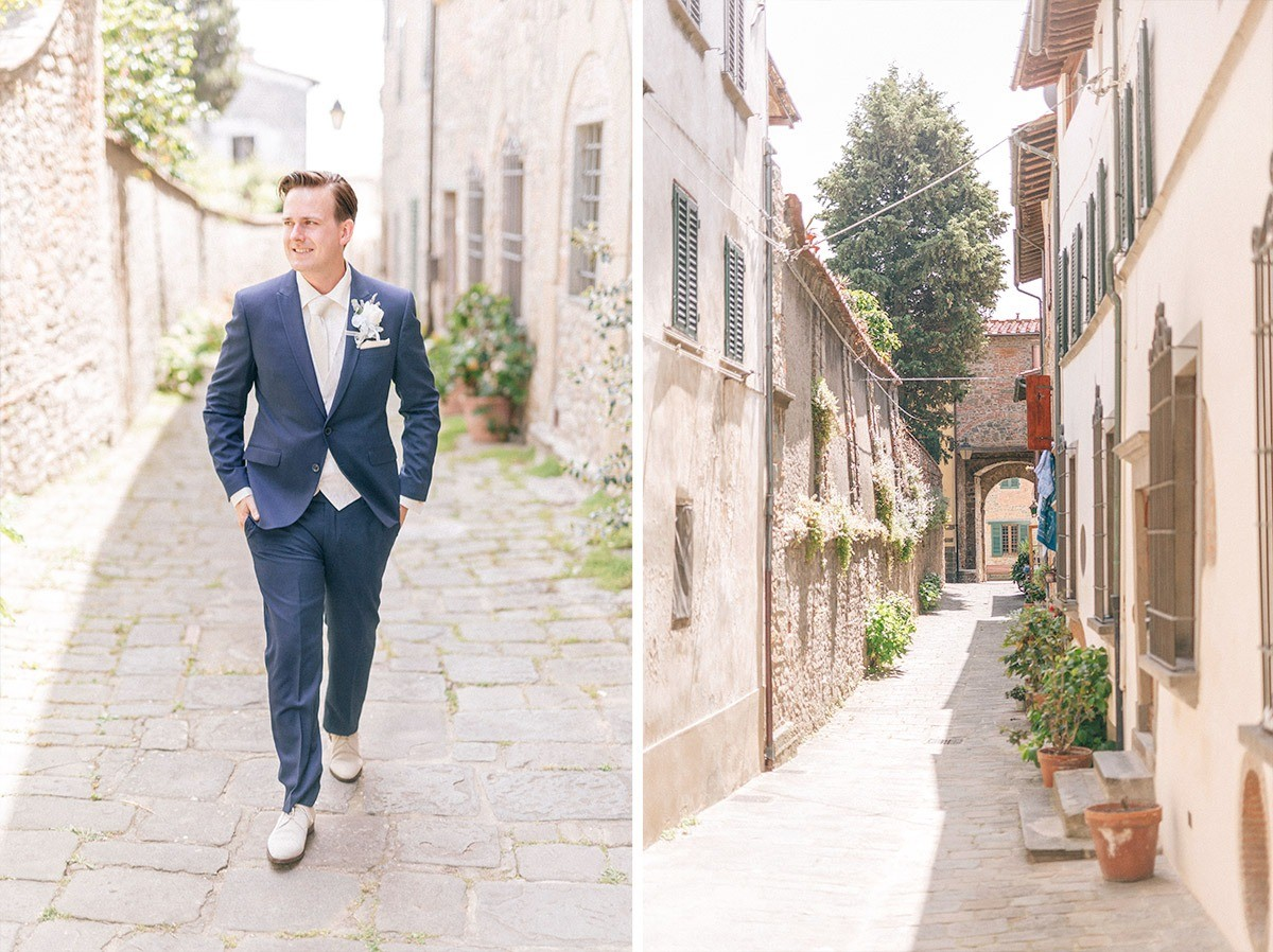 The groom walking in a burg in Tuscany
